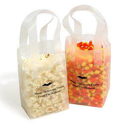 "These personalized favor bags make a great ""treat"" for little goblins at a Halloween party."